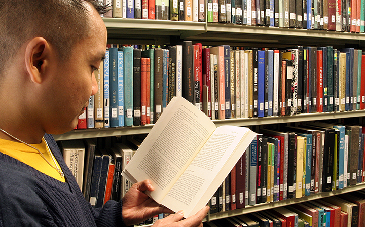 A research student Reading a book in Bill Bryson Library