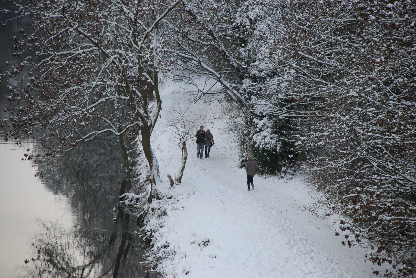 Couple walking through heavy snow by the River Wear